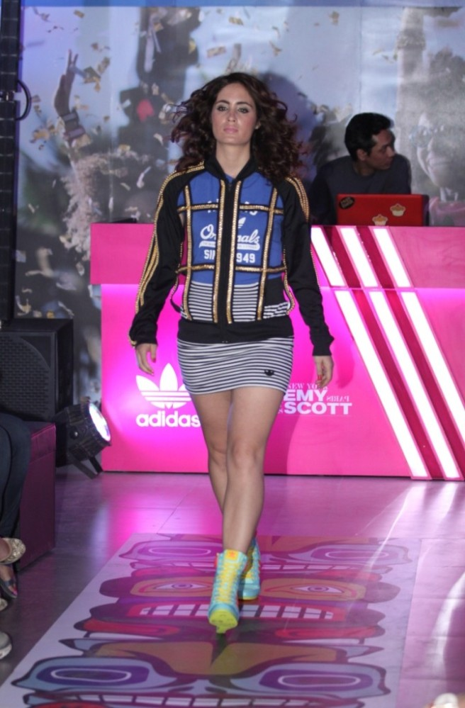 Model walkinf down the ramp in Jeremy Scott collection for adidas Originals
